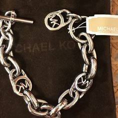 Michael Kors silver MK bracelet Authentic Michael Kors women's MK bracelet. Toggle closure. With tags. Never been used. Perfect condition. Comes with brown Michael Kors jewelry bag. Effortless style. Michael Kors Jewelry Bracelets