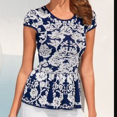 BOSTON PROPER Floral Peplum Top -Size S , M Cap sleeve floral peplum sweater    Floral jacquard stitch with button keyhole back.   Rayon/Nylon   Imported    Hand wash   Fearlessly fitted Boston Proper Tops