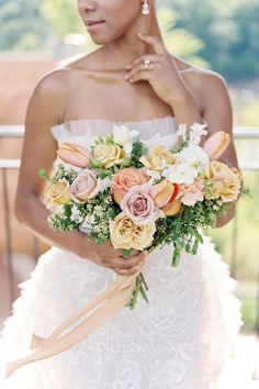 """From the editorial """"Vibrant, Feminine Wedding Inspiration for Every Modern Bride."""" From the stunning bride who is the epitome of a natural beauty to the vibrant floral arrangements with pops of pink and yellow by Luna Rose Floral Design- there is so much to love about this editorial! More details on SMP!  Photography: @lauraannewatson Florals: @lunarosefloralstudio  #weddingbouquet #weddingflowers #weddingfloraldesign #bridebouquet"""