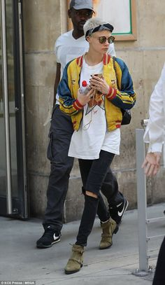 Relaxed: Underneath the bright bomber, the actress wore a large white T-shirt with a pictu...