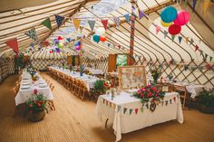 Colourful reception decorations at inside a Yurt, held in a back garden