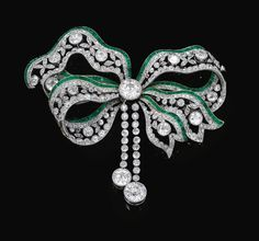 - Emerald and diamond brooch, Circa 1900
