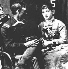 Captain Thomas ( Tom) Ward Custer.. and the woman is one of the Humphrey women, they entertained.. She is wearing Captain Thomas Custer,s 2 Congressional Medals of Honor he won during the American Civil War the only man to do so... brother of General Custer