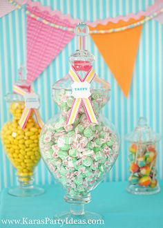 Love the easy to make ribbon on top of dispenser to show what kind of candy is inside via karaspartyideas.