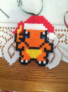 Charmander from pokemon with Santa hat ornament. $7.