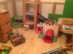 Just look at the enrichment in this rabbit room! tunnels, toys, hidey holes and more! <3