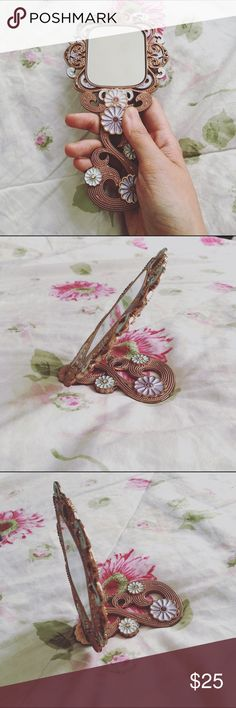 Foldable crystal handheld mirror Daisy floral pattern, carved with yellow, pink, and purple crystals. Can be folded to an almost 45 degree angle. Beautiful, elegant, and super practical gift! Comes with gift box. Bernice Accessories