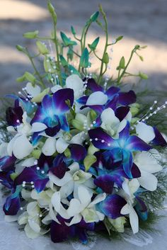 white and blue orchid bouquet..really beautiful. Maybe do this with silk flowers?