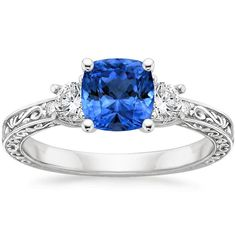 18K White Gold Sapphire Antique Scroll Three Stone Trellis Ring (1/3 ct. tw.) from Brilliant Earth