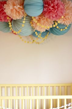 Loving this cluster of pom poms and paper lanterns. Could do in peach, mint, grey, and white.