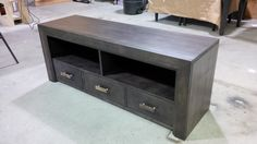 3 drawer contemporary media unit made from solid maple .  Petrified wood handles