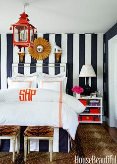 Sam Allen's Connecticut bedroom is about as Foo Dog-ular as it gets - swathed with stripes (walls and bed!), complete with antelope rug, tiger stools (mix those animal prints!!), crisp and bright hotel style linens with a big monogram, and sassy pagoda lantern. Yes, yes, and yes.