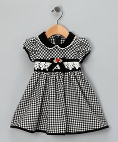 Let girls be girls in this number featuring a decorative waistline and Peter Pan collar. Dress it up or down with tights and accessories. Every little girl deserves to own at least one dress that makes her feel fancy.