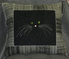 Meooow from felted wool sweaters and a bit of ingenuity.
