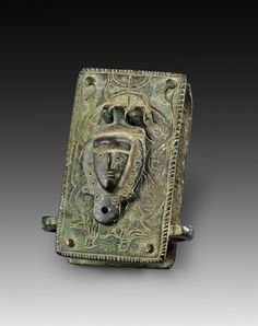 Box-shaped padlock mit incised decoration. Roman Imperial Period, 2nd - 4th century A.D. Green patina, mechanism and one side cover missing.