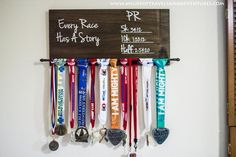 FAVORITE Race Medal Holder! I could DIY and I really like how the medals and ribbons hang so they can be seen easily!