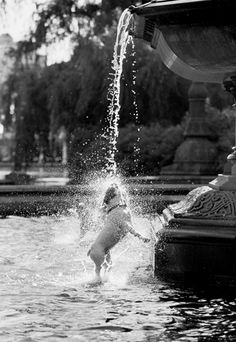 (2005). Clementine the Bulldog splashing and playing in Bethesda Fountain in Central Park, NYC.