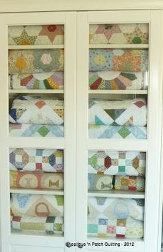 cabinet filled with lovely quilts