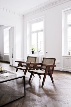 Mid-century luxury; Pierre Jeanneret chairs.