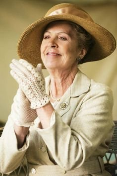 """Lovely Isobel, in her wide-brimmed summer straw & wrist length summer gloves for attending the annual Flower Show,""""Downton Abbey."""""""