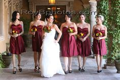 Red knee length bridesmaid dresses and black strappy heels accented by red and yellow bouquets | villasiena.cc