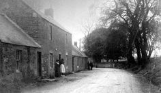 """Tour Scotland Photographs: Old photograph of cottages, houses and people in Birgham in Berwickshire, Scottish Borders, Scotland. This Scottish village is in the parish of Eccles.  (Though the """"Riding Times"""" were long over by the time this picture was taken - this area was once the stomping grounds of the Reivers.)"""
