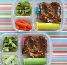 Twin pretzel #lunches in #EasyLunchboxes: Soft pretzel, kiwi fruit, sunflower kernels and carrots/cucumbers.