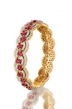 Indian Jewellery and Clothing: Diamond and ruby encrusted kada from Orra diamond jewellery..