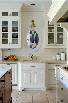 A window mirror over sink, since you cannot have a real window you can make a fake window with mirror and lots of indirect lighting!: