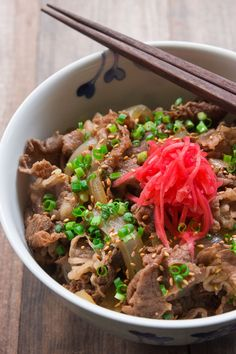 "This Yoshinoya-style Gyudon (牛丼, literally ""beef bowl""), comes together in 15 minutes and tastes delicious over a bowl steaming hot rice #japanese #japan #donburi #beef #japanesefood"