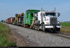 A roadrailer along with a freshly painted BN caboose heads out of Grand Forks to do some work farther south.