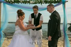 Minister Sean Rox is the Officiant for this beach wedding ceremony at the Ocean City, MD inlet:  https://www.roxbeachweddings.com/