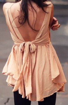 inspiration only.  love the flow of this top.  I imagine the front is fairly simple maybe a shallow v neck.  Back starts like tank but has move volume as you go down.  Ties could either start in the front and act as boob catch or be sewing into side seems to be tied in back