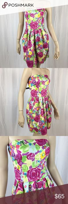 NWOT Anthropologie Tulle Floral Strapless Dress Adorable vibrant NWOT Anthropologie Tulle Floral Strapless Dress. Pleated bottom. Size medium. 27 inch waist and 27 inch length. Has pockets! 95% cotton and 5% spandex. Lining is 100% cotton Anthropologie Dresses Strapless