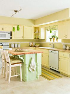 Fresh Citrus- A budget-conscious designer used pale yellow, green, and warm neutral paint to brighten up this once-dark kitchen. A new island was built using pieces of home center stock cabinetry and topped off with butcher block to give it a custom feel.
