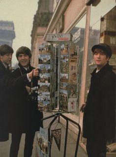 Paul McCartney, George Harrison, and John Lennon (in Paris)