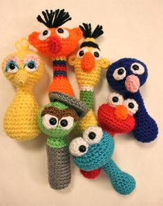 Big Bird Crochet Baby Rattle.... It's a pattern!! I don't have the crochet skills to pull if off.... But I'll find someone who does!!