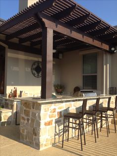 I like the pergola roof on this kitchen.