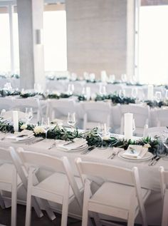 white on white wedding reception | simple white folding chairs | modern minimal wedding with rustic touches | neutral wedding | greenery garland centrepiece | Waikopou Bay, Waiheke Island | poolside waterfront wedding ceremony