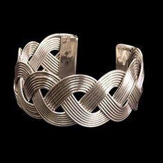 This bracelet pairs with the Celtic weave necklace #201356 and is a great compliment to any ensemble. Made of a stainless steel wire and formed into a traditional Celtic weave pattern. Adjusts to fit