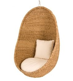 hanging chair- the colour of the woven part of the chair matches the sand on the beach and matches the light and lamp
