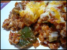 ~Un-Stuffed Pepper Casserole~    1 lb. lean ground beef;        2 green peppers, coarsely chopped;        3 cloves garlic, minced;        2 cups cooked long-grain white rice;        1 (24 oz.) can crushed tomatoes;        1-1/2 cups shredded five cheese blend, divided.  Bake at 350 for 25 minutes