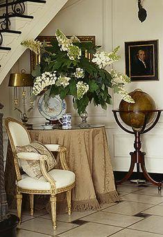 Foyer grouping with skirted table & standing globe - Jackye Lanham