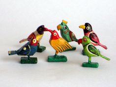 handmade wooden birds 6 bird figurines hand painted hand sculpted wood sculpture set of 6 birds. $17.00, via Etsy.
