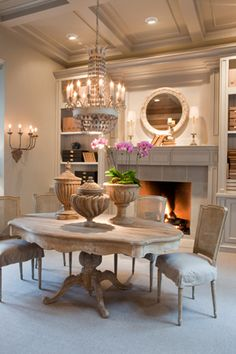 Aidan Gray. Put a fireplace insert in the dining room with a mirror and shelfing around.