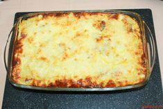 Cartofii gratinati la cuptor cu branza, cascaval, sunca, oua si smantana