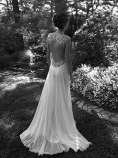 Flowing with beautiful keyhole back wedding dress