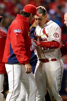 Allen Craig is helped off of the field after scoring the winning run against the Boston Red Sox in the ninth inning of game 3 of the 2013 WS.  10-26-13.