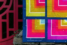 Detail shot of Bungalow, a quilt from the Alison Glass Sew series   Insignia, from Andover fabrics, makes a vibrant color palette for this modern quarter square log cabin quilt variation
