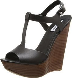 $54, Black Leather Wedge Sandals: Steve Madden Bittles Wedge Sandal. Sold by Amazon.com. Click for more info: https://lookastic.com/women/shop_items/125561/redirect